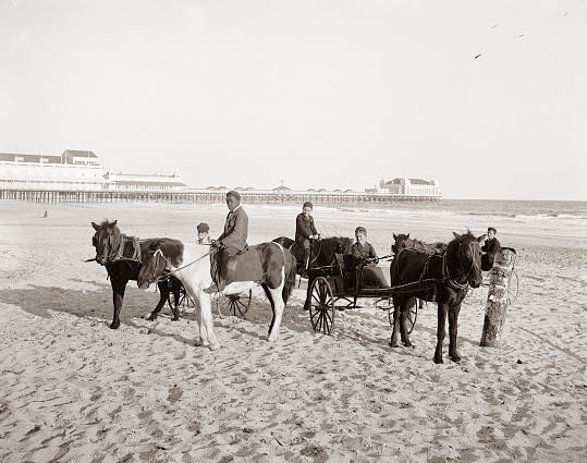 Today's picture is from 1900, and it shows some children with ponies on the