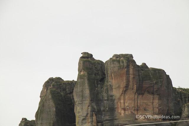 Meteora rocks in the clouds closeup II