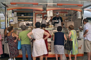 Older women waiting for butcher in Vernazza, Italy.