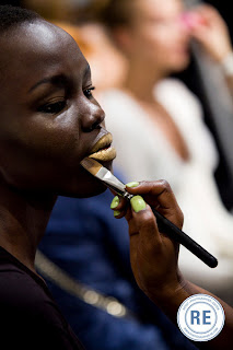 Gold Metallic Powder and Mixing Liquid being applied to a Model at Fashion Week