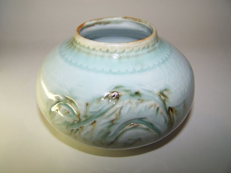 Carved Light Blue Celadon Vase