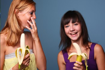 women eating bananas