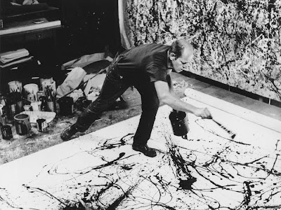 Pollock Jackson. throwing paint. high angle. cropped