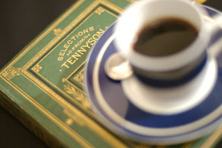 Book of Tennyson poems with a teacup