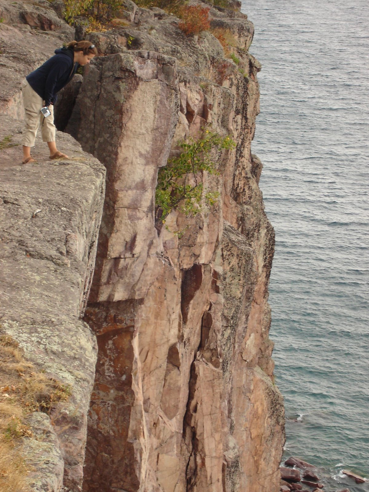 looking over the edge at palisade head, north shore, minnesota