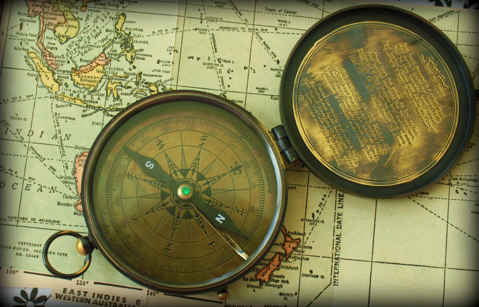 Vintage compass on a vintage map.