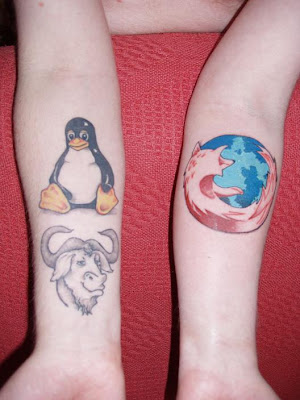 firefox and linux tattoo on hands