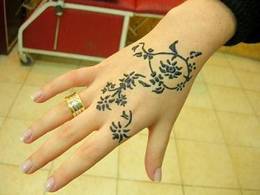 pretty hand tattoo flower style