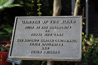 This is a sign that was in the garden, it says Garden of the Blind, built by the generosity of those who care