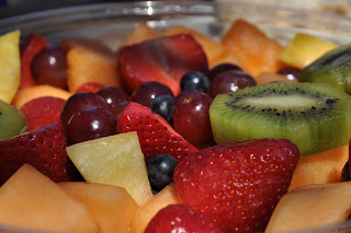 Close up of our mixed fruit bowl, there's strawberries, cantelope, pineapple, kiwis, grapes, and blueberries
