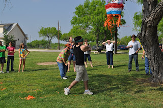 Darrell in the last stage of his swing, the pinata is about 4 feet above his head