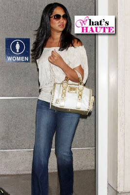 Celeb bag spotting: Kimora Lee Simmons with Versace Quilted Snap Out Of It Bag
