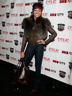 R&B singer Monica with Louis Vuitton Embossed Large Leather Tote Bag