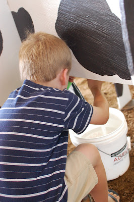 H Milking a cow