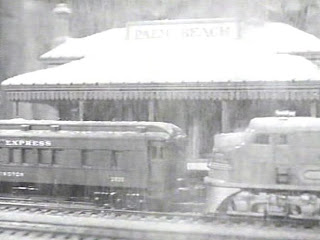Holiday Affair (1949): Opening shot, the toy train station PALM BEACH covered with snow