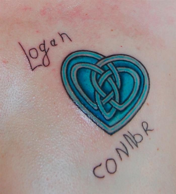 "Corrine's ""mother love heart"" tattoo bears the signatures of her sons ..."