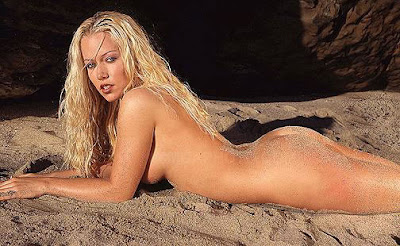 Kendra Wilkinson nude on the beach