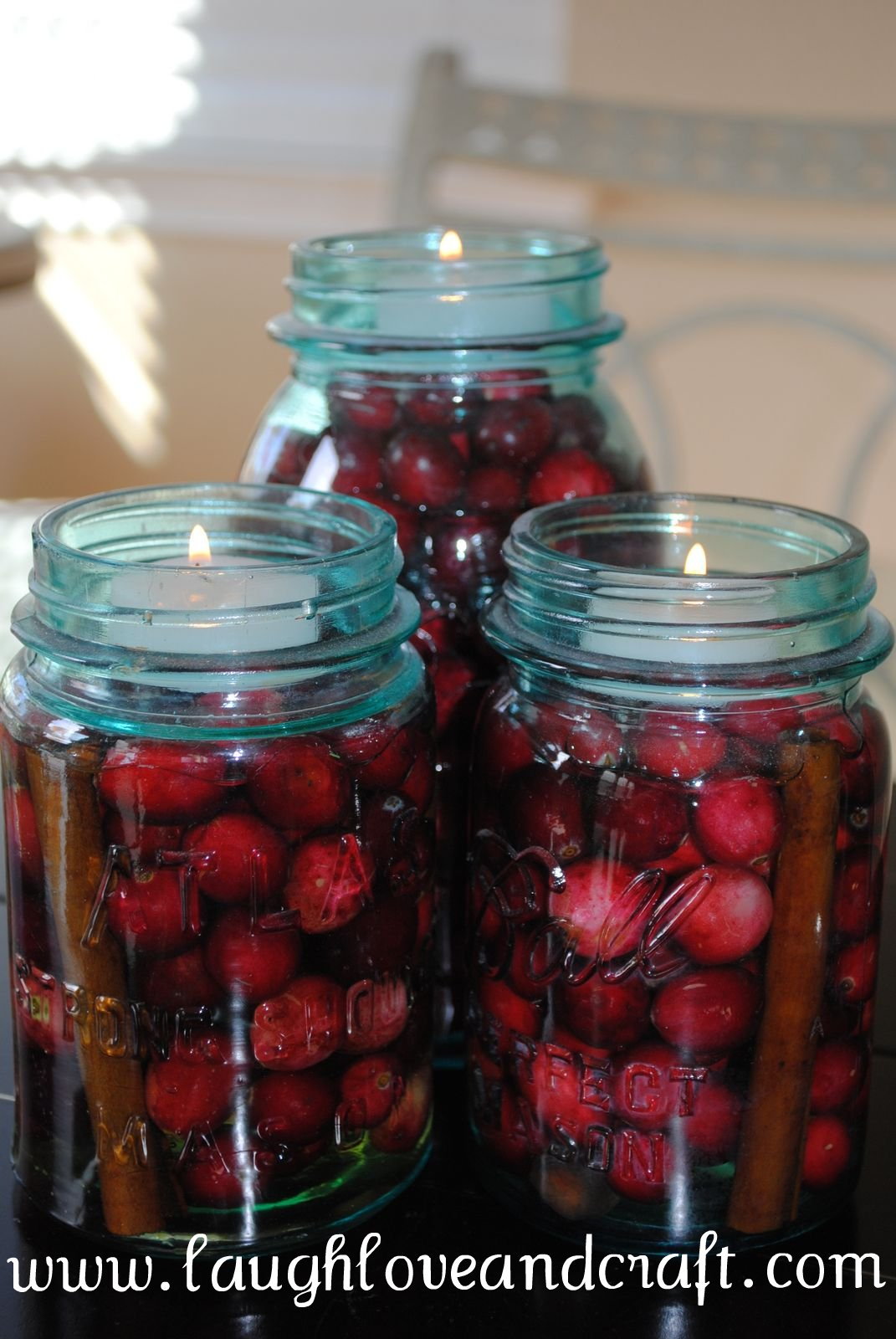 Mason Jars with Cranberries and Candles