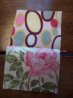 Pink quilt fabric made into pillows using log cabin quilt pattern