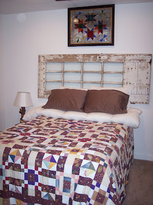 Old Wooden Door has Head Board and Old Quilt