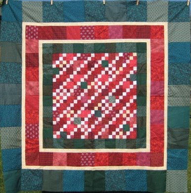 Different Sizes of Square made into a Quilt