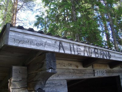 URL graffiti on a forest shelter