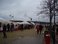 Christmas market in Nynäshamn harbour, S/S Blidösund in background