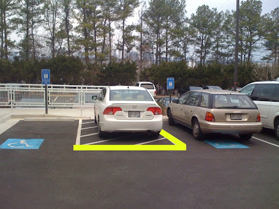 image of car parked in handicapped parking space with yellow line edited into the photo