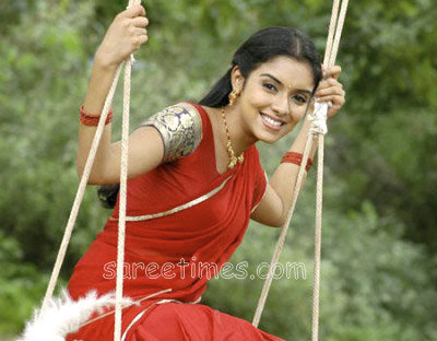 Bollywood and South Indian actress Asin in beautiful red half sari with thin