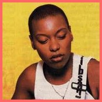 MeShell NdegeOcello with a shaved head