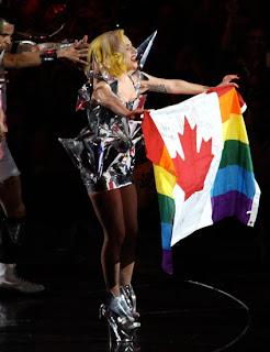 Lady Gaga, holding a rainbow Canadian flag