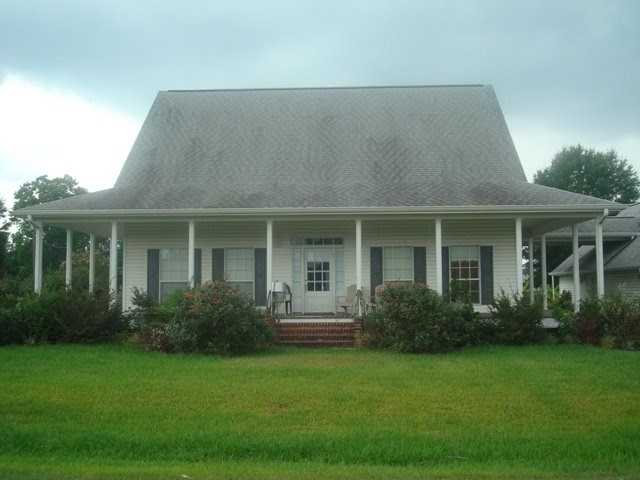 See lafayette homes acadian style w wrap around porch for Acadian style homes with pictures