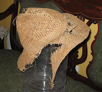 H's hat