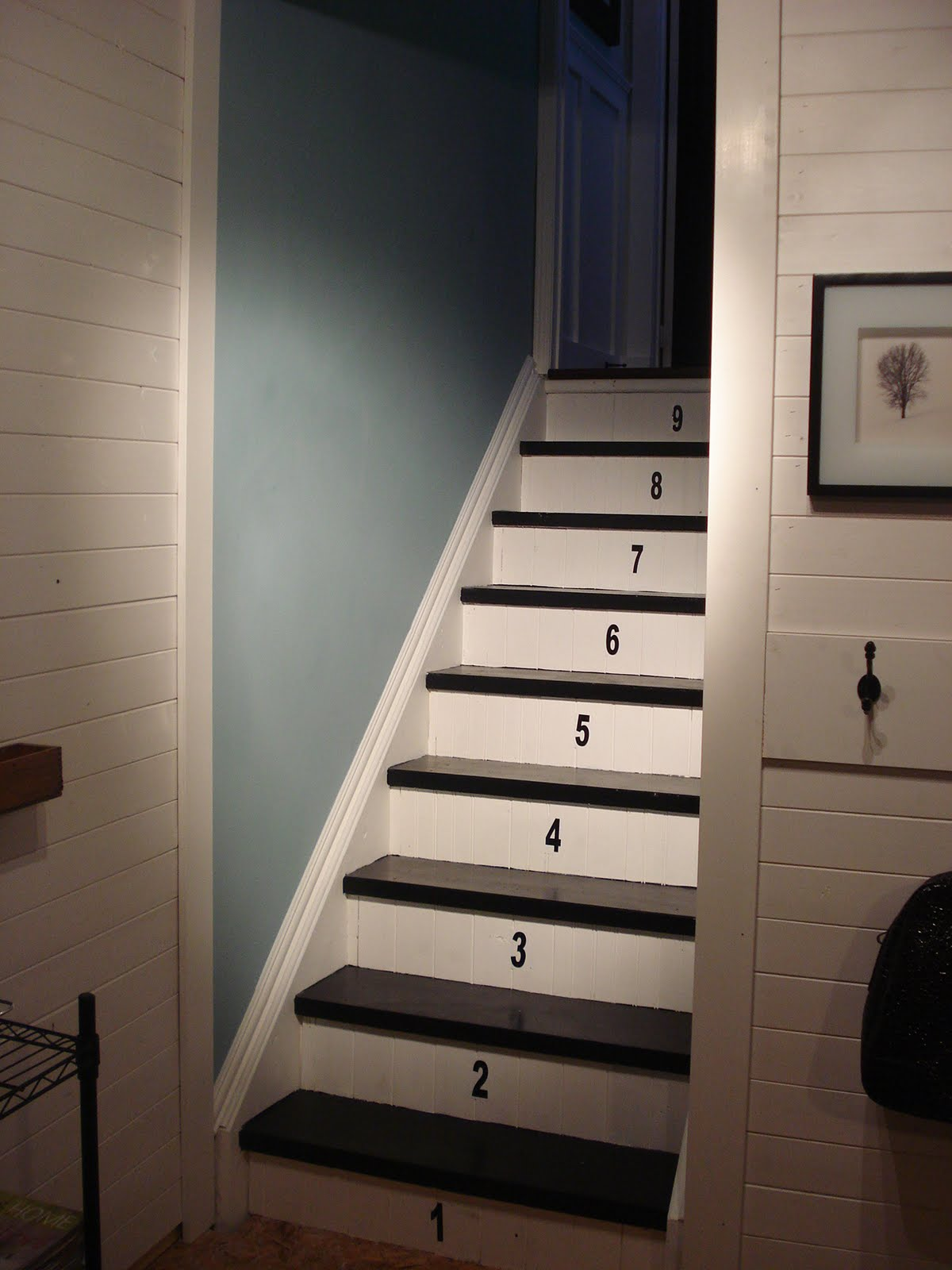 have finally finished the basement stair makeover which included