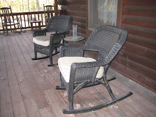 two wicker rocking chairs on my front porch