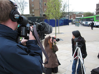 Jennie being besieged by the local press