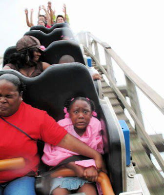 scared girl on roller coaster