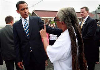 Obama and a moonbat supporter. Love the hair, don't you?