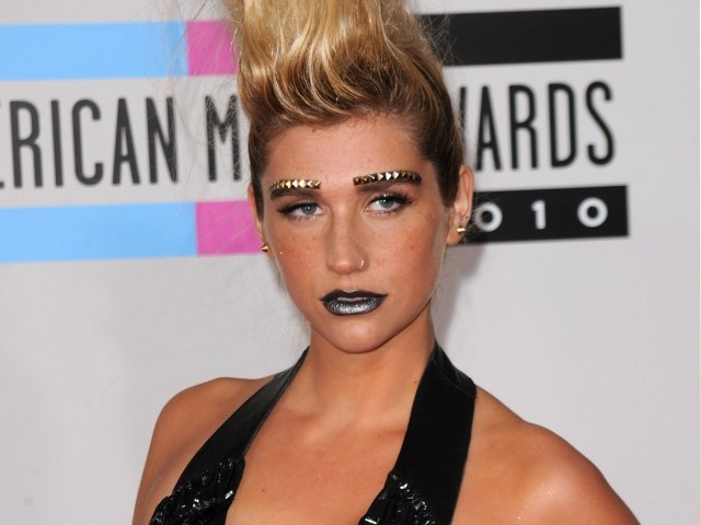 kesha makeup less. and her makeup was ridiculous.