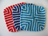 3 brightly-colored washcloths