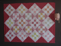 Crib sized quilt top in pink