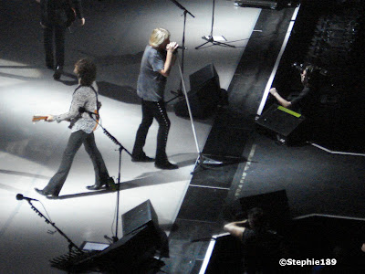 Part of Phil Collen, Vivian Campbell, Joe Elliott, their cameraman, and is that Ross Halfin? Def Leppard in concert 2007