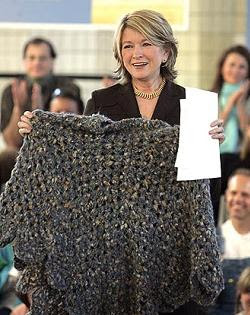 Martha Stewart holding the Poncho of Shame