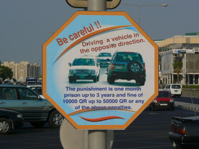 Qatari Road Sign: warning drivers not to go against the flow of traffic.