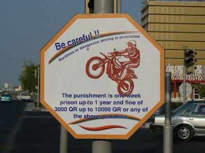 Qatari Road Sign: warning against Dangerous driving