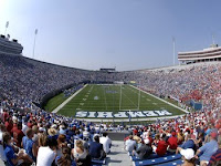 View from the end zone at a Memphis football game on a blue sky sunny day.