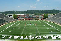 View from the end zone of an empty Marshall University football stadium.