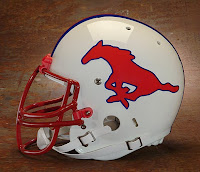 SMU football helmet. White football helmet with red mustang painted on and red face mask.
