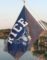 Rice flag with owl flying over water.