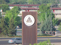 New Mexico college seal on tall building.